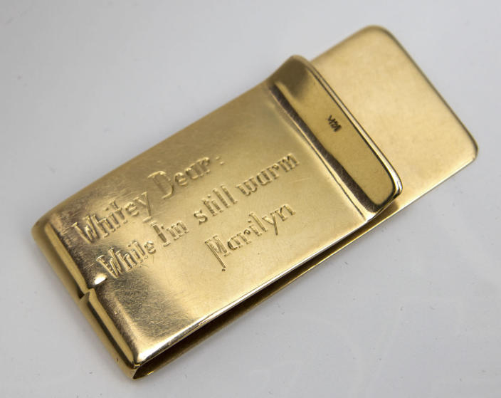 """This undated image released by Julien's Auctions, shows a Tiffany Money Clip, stamped 14K gifted to Allan """"Whitey"""" Snyder from Marilyn Monroe. This item is part of Julien's Auctions Hollywood Legends being held on Saturday, March 31, 2012 and Sunday April 1 in Beverly Hills, Calif. (AP Photo/Julien's Auctions)"""