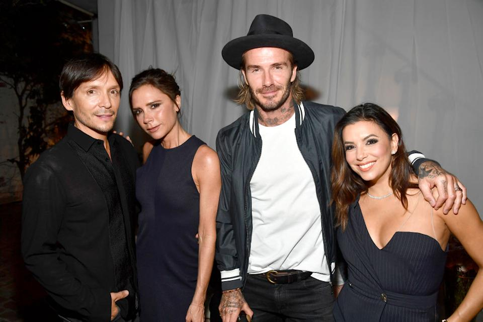 Eva Longoria (r) and the Beckhams are firm friends, pictured with hairdresser Ken Paves (l) in October 2017. (Frazer Harrison/Getty Images)
