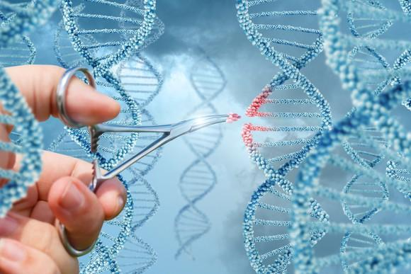 Hand with scissors removing part of DNA