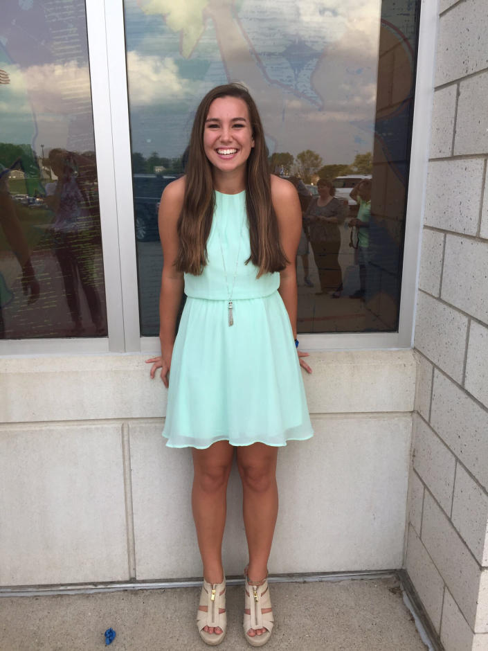 In this September 2016 photo provided by Kim Calderwood, Mollie Tibbetts poses for a picture during homecoming festivities at BGM High School in her hometown of Brooklyn, Iowa. Cristhian Bahena Rivera, the man charged with killing Tibbetts while she was out for a run in July 2018, will stand trial for first-degree murder on Monday, May 17, 2021, in Davenport, Iowa. (Kim Calderwood via AP)
