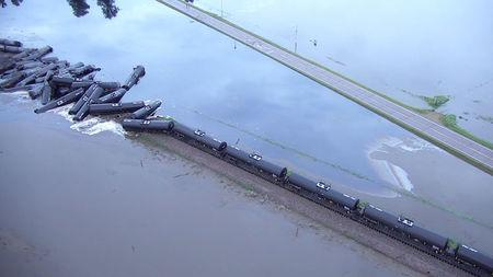 Tanker cars from a freight train carrying crude oil are shown after a derailment  along the Rock River south of Doon, Iowa, U.S. in this June 22, 2018 handout still image taken from aerial drone video.   Sioux County Sheriff's Office/Handout via REUTERS