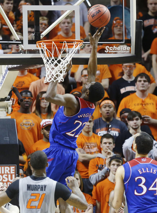 Kansas guard Andrew Wiggins (22) shoots in front of Oklahoma State post Kamari Murphy (21) in the second half of an NCAA college basketball game in Stillwater, Okla., Saturday, March 1, 2014. Oklahoma State won 72-65. (AP Photo/Sue Ogrocki)