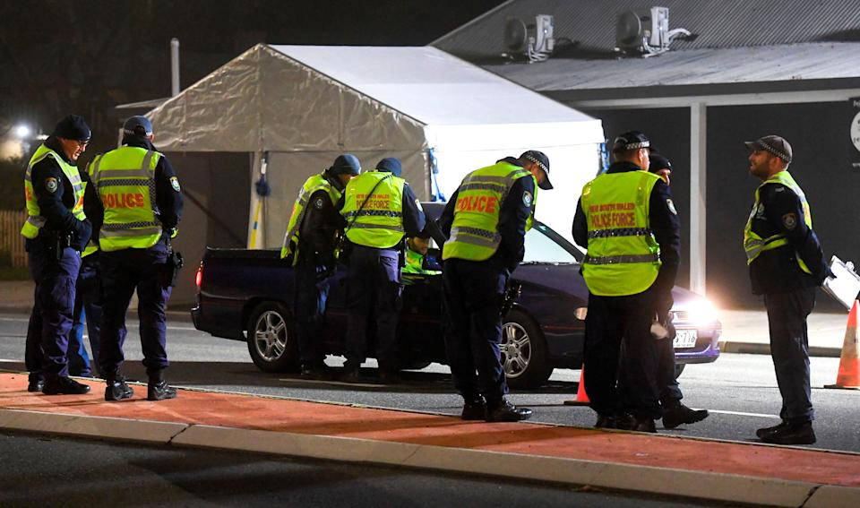 Police in the southern New South Wales (NSW) border city of Albury check cars crossing the state border from Victoria on July 8, 2020 (Photo by WILLIAM WEST/AFP via Getty Images) (Photo: WILLIAM WEST via Getty Images)