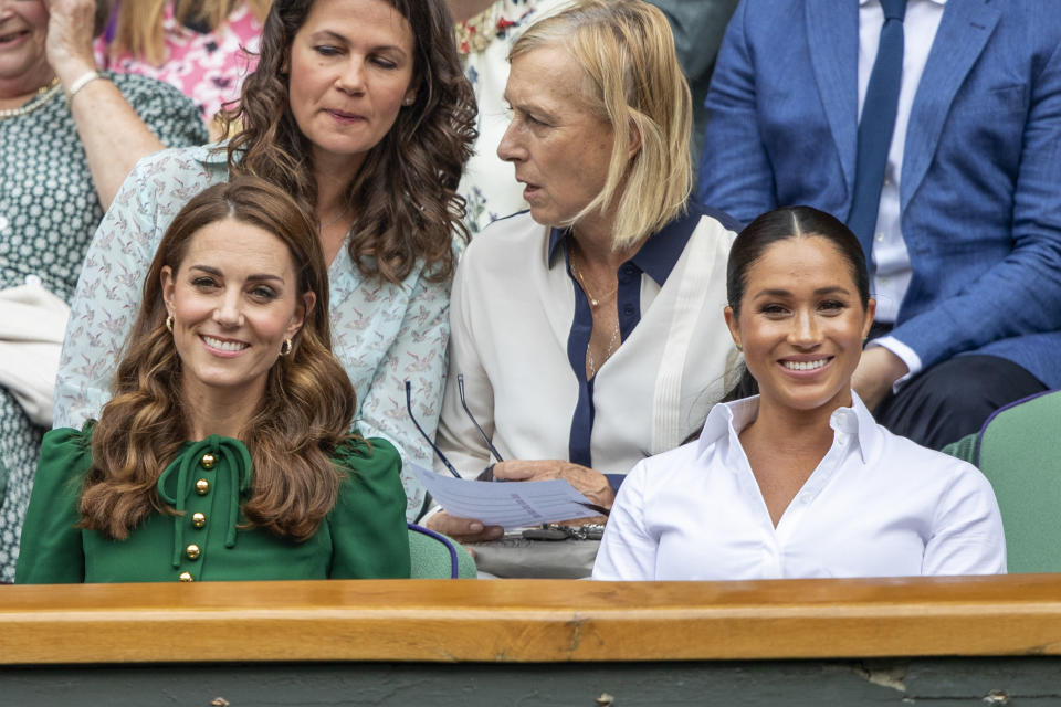 LONDON, ENGLAND - July 13:   Catherine, Duchess of Cambridge and Meghan, Duchess of Sussex in the Royal Box on Centre Court during the Serena Williams of the United States match against Simona Halep of Romania during the Ladies Singles Final on Centre Court during the Wimbledon Lawn Tennis Championships at the All England Lawn Tennis and Croquet Club at Wimbledon on July 13, 2019 in London, England. (Photo by Tim Clayton/Corbis via Getty Images)