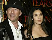 """Actor Bruce Willis and Italian actress Monica Bellucci, stars of the new drama film """"Tears of the Sun,"""" pose at the film's premiere in Los Angeles, March 3, 2003. The film opens March 7 in the United States. REUTERS/Fred Prouser FSP"""