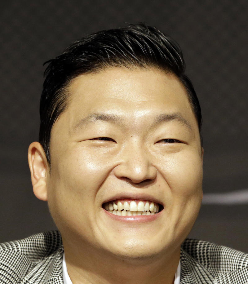 """South Korean rapper PSY, who sings the popular """"Gangnam Style"""" song, smiles during a press conference in Seoul, South Korea, Tuesday, Sept. 25, 2012. (AP Photo/Lee Jin-man)"""