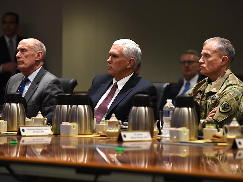From left, Director of National Intelligence Dan Coats, Vice President Mike Pence and Defense Intelligence Agency Director Lt. Gen. Robert Ashley listen to an intelligence brief during the Vice President€'s visit to DIA headquarters Nov. 6, at Joint Base Anacostia-Bolling in Washington, D.C. (Photo: DIA Public Affairs)