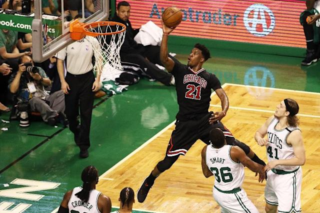 Jimmy Butler of the Chicago Bulls takes a shot against the Boston Celtics during the third quarter of Game One of the Eastern Conference quarter-finals, at TD Garden in Boston, Massachusetts, on April 16, 2017 (AFP Photo/Maddie Meyer)