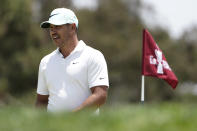 Brooks Koepka walks on the first green during a practice round of the U.S. Open Golf Championship, Tuesday, June 15, 2021, at Torrey Pines Golf Course in San Diego. (AP Photo/Jae C. Hong)