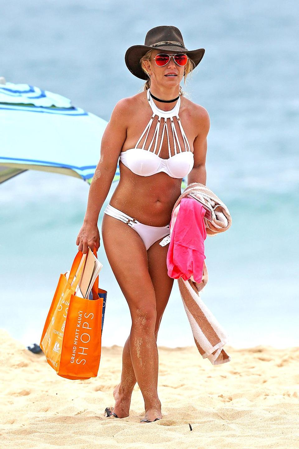 <p>The Hawaiian mama's tan lines are gonna be a hot mess, but she's Britney, bitch — she's handled much worse. (Photo: FameFlynet/AKM-GSI) </p>