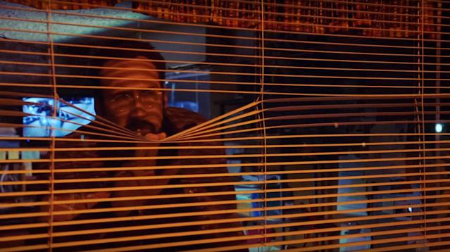 Cage plays a peeping Tom in <em>Looking Glass.</em> (Photo: Momentum Pictures/Courtesy Everett Collection)