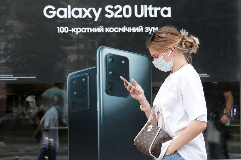 FILE PHOTO: A woman walks past a Samsung brand store in central Kyiv