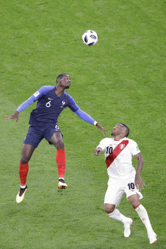 France's Paul Pogba, left, and Peru's Jefferson Farfan challenge for the ball during the group C match between France and Peru at the 2018 soccer World Cup in the Yekaterinburg Arena in Yekaterinburg, Russia, Thursday, June 21, 2018. (AP Photo/Mark Baker)