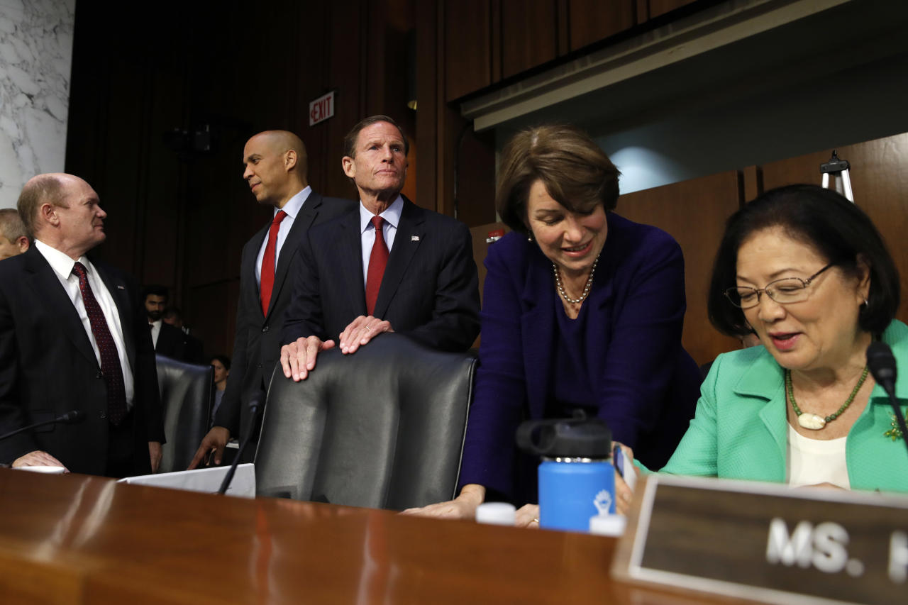 <p>From left, Sen. Chris Coons, D-Del., Sen. Cory Booker, D-N.J., Sen. Richard Blumenthal, D-Conn., Sen. Amy Klobuchar, D-Minn., and Sen. Mazie Hirono, D-Hawaii, talk during a break from testimony in the third round with President Donald Trump's Supreme Court nominee, Brett Kavanaugh, on the third day of his Senate Judiciary Committee confirmation hearing, Thursday, Sept. 6, 2018, on Capitol Hill in Washington, to replace retired Justice Anthony Kennedy. (Photo: Jacquelyn Martin/AP) </p>
