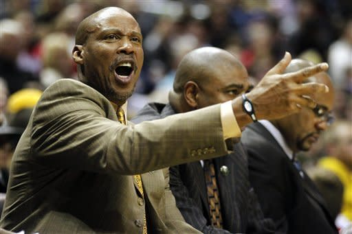 Cleveland Cavaliers head coach Byron Scott argues a call with an official during the first half of an NBA basketball game against the Milwaukee Bucks, Wednesday, April 4, 2012, in Milwaukee. (AP Photo/Jeffrey Phelps)