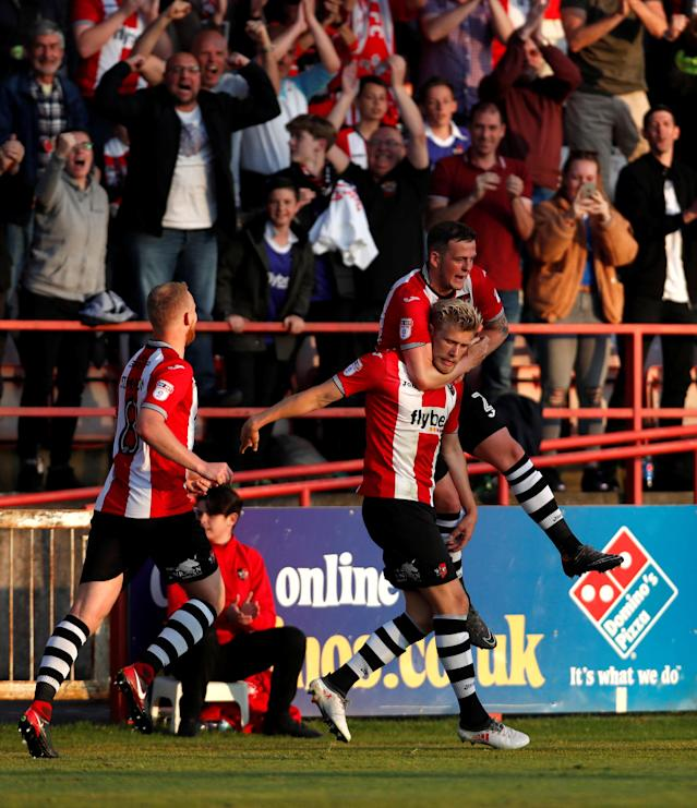 "Soccer Football - League Two Play Off Semi Final Second Leg - Exeter City vs Lincoln City - St James Park, Exeter, Britain - May 17, 2018 Exeter City's Jayden Stockley celebrates after he scores the first goal Action Images/Paul Childs EDITORIAL USE ONLY. No use with unauthorized audio, video, data, fixture lists, club/league logos or ""live"" services. Online in-match use limited to 75 images, no video emulation. No use in betting, games or single club/league/player publications. Please contact your account representative for further details."