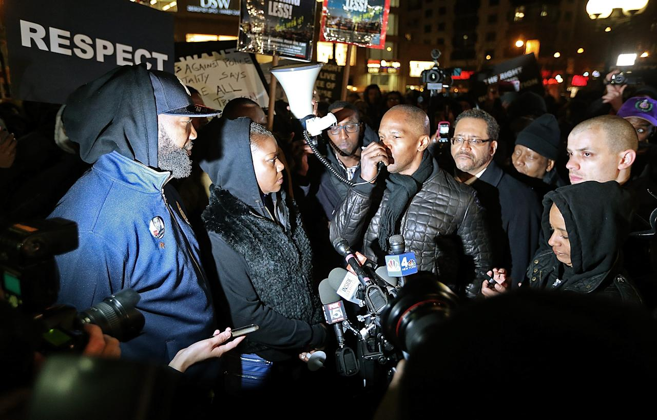 NEW YORK, NY - FEBRUARY 26:  Actor Jamie Foxx (Center-R) speaks next to Tracy Martin (L) and Sybrina Fulton (2nd L), Trayvon Martin's parents, during a candlelight vigil for Martin in Union Square on February 26, 2013 in New York, New York.  Some participants wore hoodies to honor Martin. Vigils were held in Florida and New York on the one year anniversary of teenager Trayvon Martin's shooting death by George Zimmerman in Florida.  (Photo by Mario Tama/Getty Images)