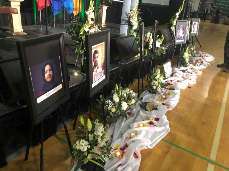 A memorial service is held for crash victims at the Saville Community Sports Centre in Edmonton, Canada on January 12