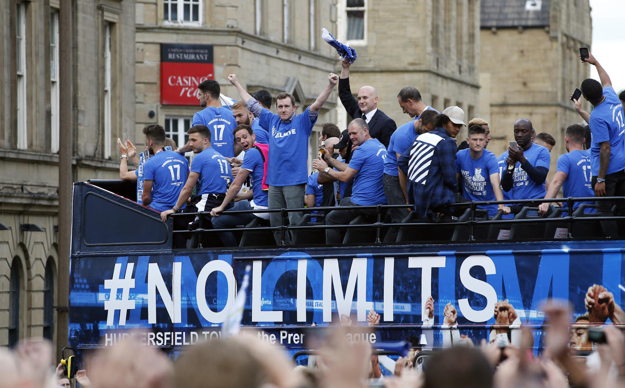 Britain Soccer Football - Huddersfield Town - Premier League Promotion Winners Parade - Huddersfield - 30/5/17 Huddersfield Town chairman Dean Hoyle celebrates on the bus during the parade Action Images via Reuters / Craig Brough Livepic EDITORIAL USE ONLY.