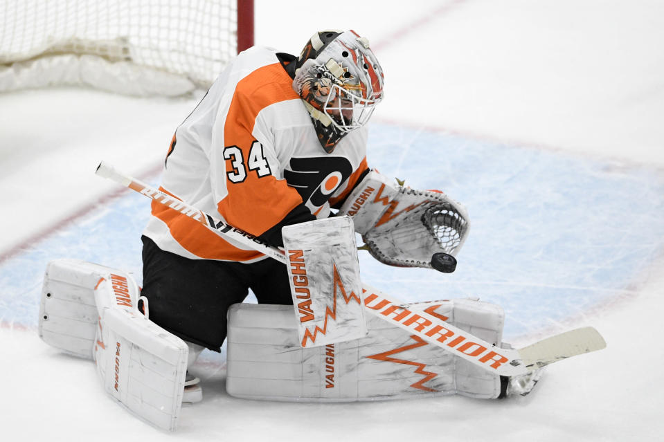 Philadelphia Flyers goaltender Alex Lyon stops the puck during the first period of the team's NHL hockey game against the Washington Capitals, Saturday, May 8, 2021, in Washington. (AP Photo/Nick Wass)