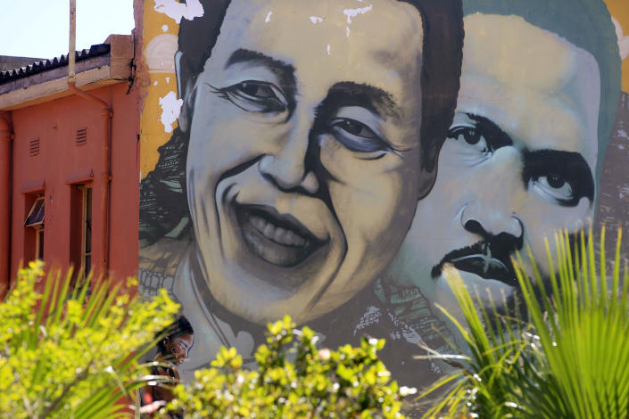 Former South African President Nelson Mandela, left, is pictured on a mural with South African apartheid freedom fighter Steve Biko, right, in the city of Cape Town, South Africa, Sunday, March 10, 2013. South Africa's presidency says Nelson Mandela has spent a night in the hospital after he was admitted for tests. Presidential spokesman Mac Maharaj said Sunday there were no updates on 94-year-old Mandela's condition since he went to a hospital in Pretoria on Saturday afternoon.(AP Photo/Schalk van Zuydam)