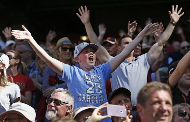 """Baseball fans will be able to playback their """"15 second of fame"""" during MLB broadcasts. (AP)"""