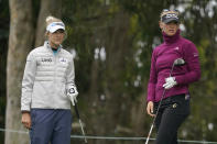 Jessica Korda, right, watches her drive from the fifth tee next to her sister, Nelly Korda, during a practice round at the U.S. Women's Open golf tournament in San Francisco, Wednesday, June 2, 2021. (AP Photo/Jeff Chiu)
