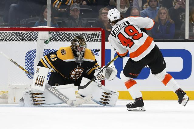 Philadelphia Flyers' Joel Farabee (49) scores on Boston Bruins' Jaroslav Halak (41) during the shootout in an NHL hockey game in Boston, Sunday, Nov. 10, 2019. (AP Photo/Michael Dwyer)