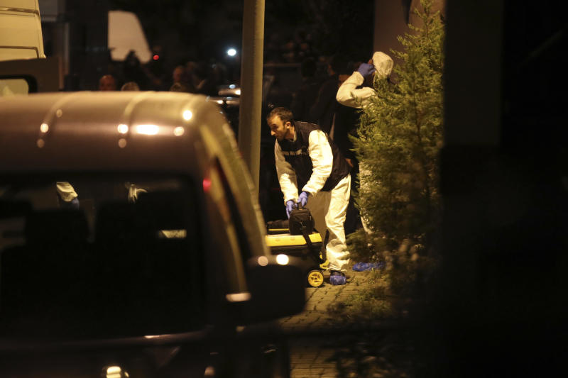 Turkish police officers gather as they prepare to enter the Saudi Arabia's Consulate in Istanbul, Monday, Oct. 15, 2018. Turkish crime scene investigators dressed in coveralls and gloves entered the consulate Monday, nearly two weeks after the disappearance and alleged slaying of Saudi writer Jamal Khashoggi there. (AP Photo/Petros Giannakouris)
