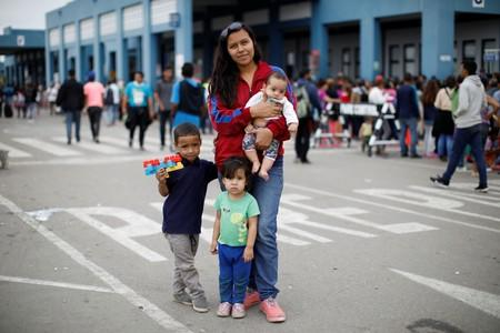 The Wider Image: Venezuelan mothers, children in tow, rush to migrate