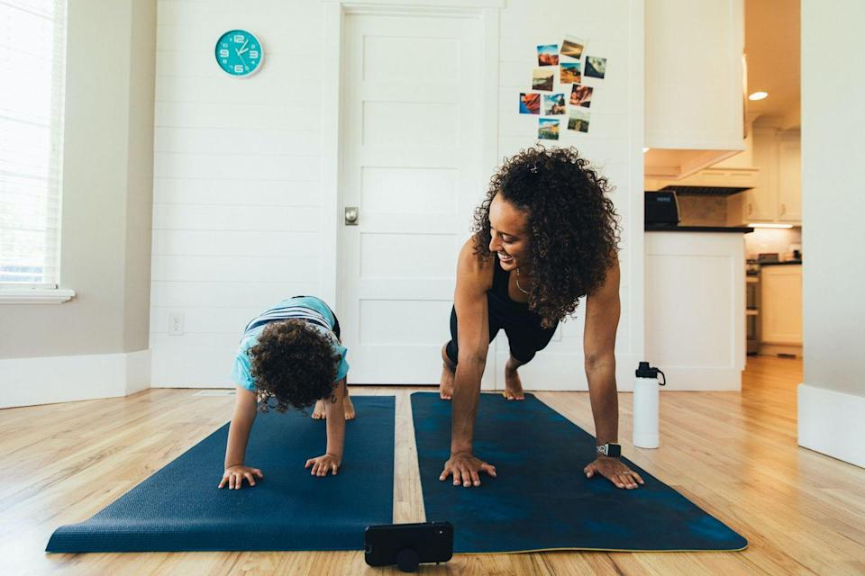 """<p>If mom enjoys getting her fitness on, join in on the action and attend a """"mom and me"""" workout class. Due to the ongoing pandemic forcing gyms to close, a new fitness trend of <a href=""""https://www.goodhousekeeping.com/health/fitness/a31792038/coronavirus-live-stream-workout-classes/"""" rel=""""nofollow noopener"""" target=""""_blank"""" data-ylk=""""slk:virtual classes and at-home workouts"""" class=""""link rapid-noclick-resp"""">virtual classes and at-home workouts</a> has emerged. Whether it's yoga, pilates, spin classes, or high-intensity interval training (HIIT) classes, there are a number of virtual workout classes to choose from that will help Mom get her sweat on.</p>"""