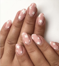 <p>If you're looking for something a bit more subtle but still want to look patriotic, go for simple white stars over a nude base for an understated look that still pops. </p>