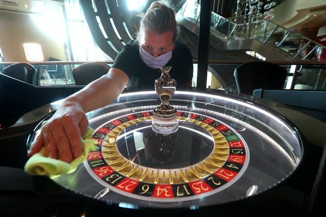 Worker cleans a roulette wheel