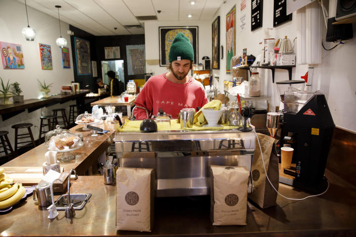 John Schwarz, co-owner of Weird Wave Coffee, prepares a beverage in the Boyle Heights, Los Angeles, shop. (Photo: Patrick T. Fallon for Yahoo News)