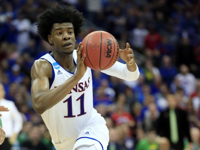 Josh Jackson passes the ball in a March 25, 2017, file photo. The former Kansas star must undergo anger management classes and apologize as part of a diversion agreement arising from a confrontation with a women's basketball player. (AP)
