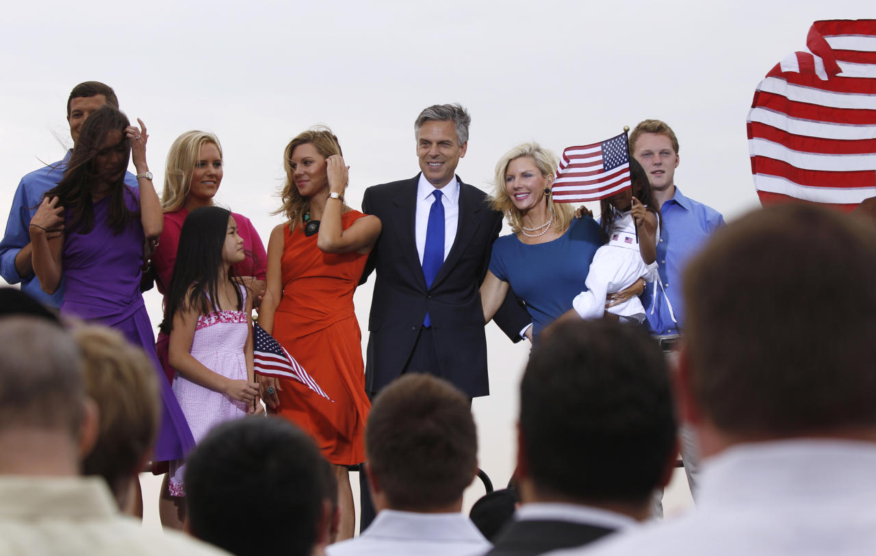 Former Utah Gov. Jon Huntsman stands with family pose after he announced his bid for the Republican presidential nomination, Tuesday, June 21, 2011, at Liberty State Park in Jersey City, N.J. (AP Photo/Mel Evans)