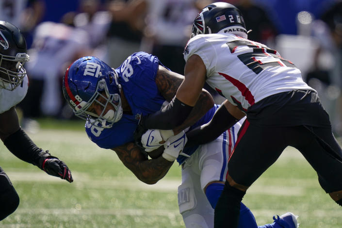 New York Giants tight end Evan Engram (88) fumbles before Atlanta Falcons cornerback Isaiah Oliver (26) recovers the ball during the first half of an NFL football game, Sunday, Sept. 26, 2021, in East Rutherford, N.J. (AP Photo/Seth Wenig)