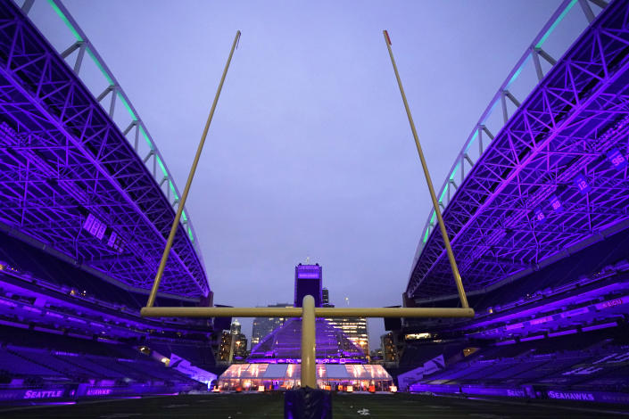 "An outdoor dining tent set up at Lumen Field, the home of the Seattle Seahawks NFL football team, is shown as viewed from the south end zone, Thursday, Feb. 18, 2021, in Seattle. The ""Field To Table"" event was the first night of several weeks of dates that offer four-course meals cooked by local chefs and served on the field at tables socially distanced as a precaution against the COVID-19 pandemic, which has severely limited options for dining out at restaurants in the area. (AP Photo/Ted S. Warren)"