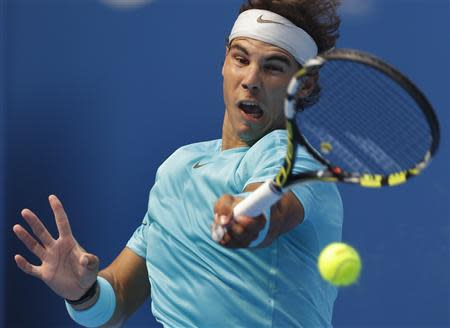 Rafael Nadal of Spain returns a shot during his quarterfinal match against Fabio Fognini of Italy in the China Open tennis tournament at the National Tennis Stadium, in Beijing October 4, 2013. REUTERS/Jason Lee