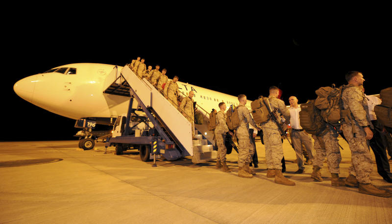 In this photo released by the Australian Department of Defense, U.S. Marine Corps, Fox Company, 2nd Battalion 3rd Marine Regiment arrive at the Royal Australian Air Force Base in Darwin, Australia, Tuesday night, April 3, 2012. The first detachment of 200 U.S. Marines has arrived in northern Australia, where a permanent joint training hub is taking shape as part of a U.S. shift of military strength in the Asia-Pacific region. (AP Photo/Australian Department of Defense, Chris Dickson) NO SALES, EDITORIAL USE ONLY