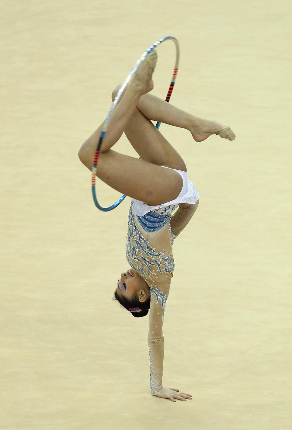 LONDON, ENGLAND - JANUARY 16: Varvara Filiou of Greece in action in the Individual All-Around during the FIG Rhythmic Gymnastics Olympic Qualification round at North Greenwich Arena on January 16, 2012 in London, England. (Photo by Ian Walton/Getty Images)