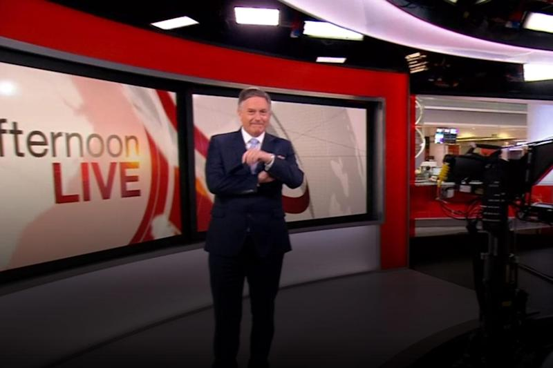 Time goes on: Simon McCoy checked his watch as he joked about it 'still being afternoon' (BBC)