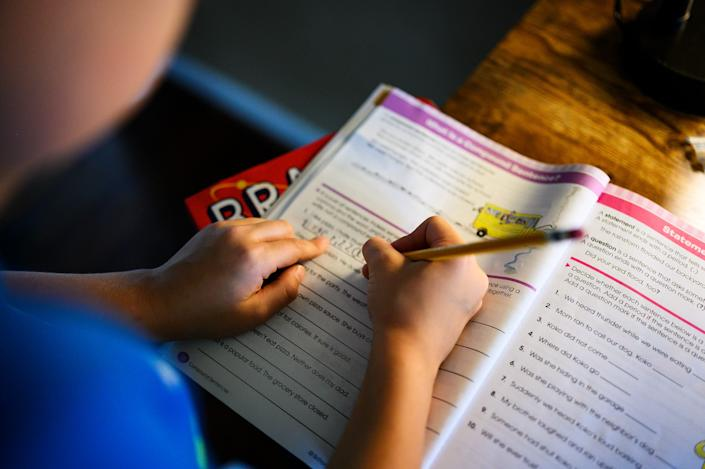 Woodland Elementary School student William Gordon, 8, does compound sentence exercises at home Monday, Aug. 24, 2020.
