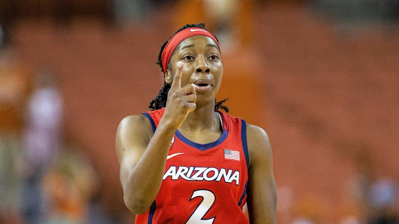 Arizona guard Aari McDonald (2) calls out to her teammates against Texas on Sunday. (AP Photo/Stephen Spillman)