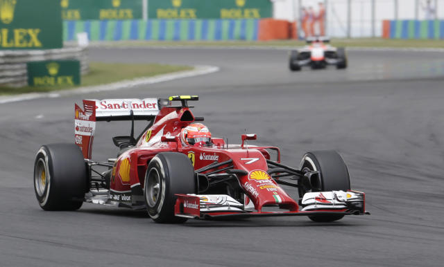 Ferrari driver Kimi Raikkonen of Finland steers his car during the qualifying of the Hungarian Formula One Grand Prix in Budapest, Hungary, Saturday, July 26, 2014. The Hungarian Grand Prix will be held on Sunday, July 27, 2014. (AP Photo/Petr David Josek)