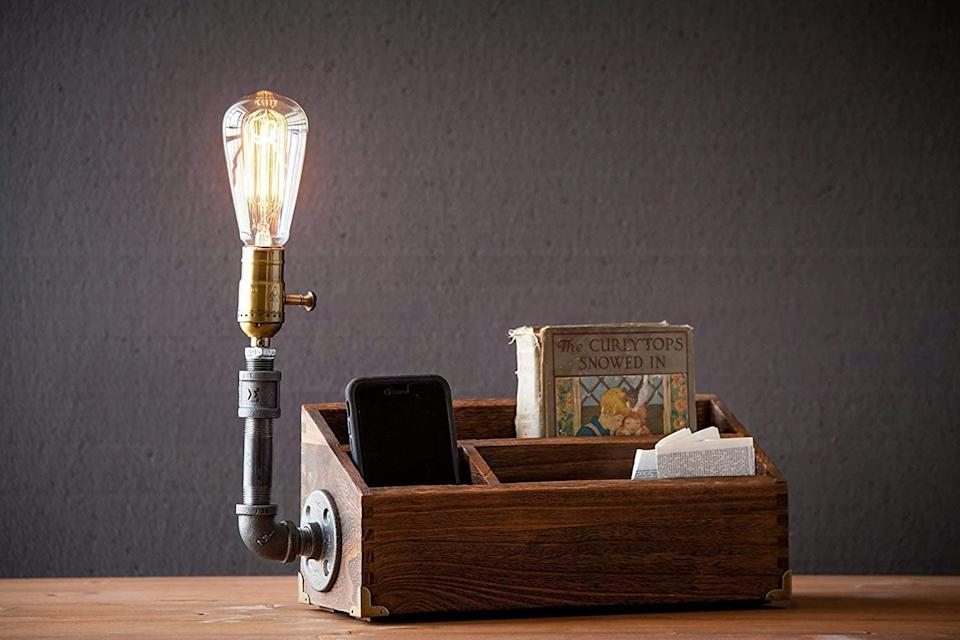 <p>If they are working from home or have a cool home office, elevate their space with this <span>Industrial Steampunk Pipe Desk Organizer Table Lamp</span> ($79). It has storage for all their desk necessities including pens, notepads, chargers and more. Plus, you can customize it with your choice of bulb and socket style. </p>