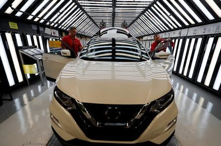 Workers are seen on the production line at Nissan's car plant in Sunderland Britain