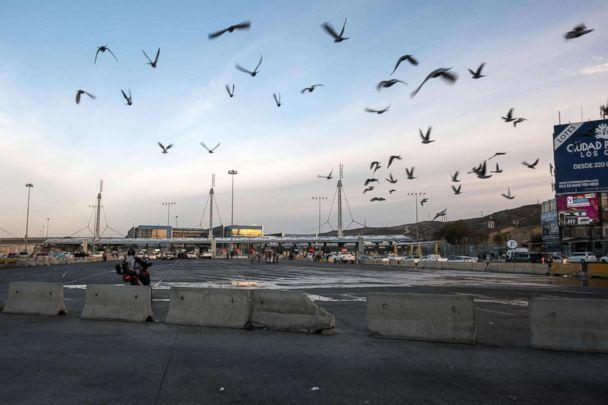 PHOTO: Birds fly over almost empty border crossing lines, after U.S. authorities temporarily closed the San Ysidro port of entry at the US-Mexico border, as seen from Tijuana, Mexico, Nov. 19, 2018. (Guillermo Arias/AFP/Getty Images)