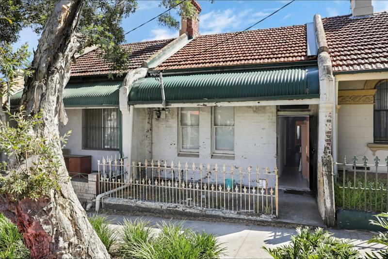 The worn front of the Pine Street property that is being sold by LJ Hooker Newtown.