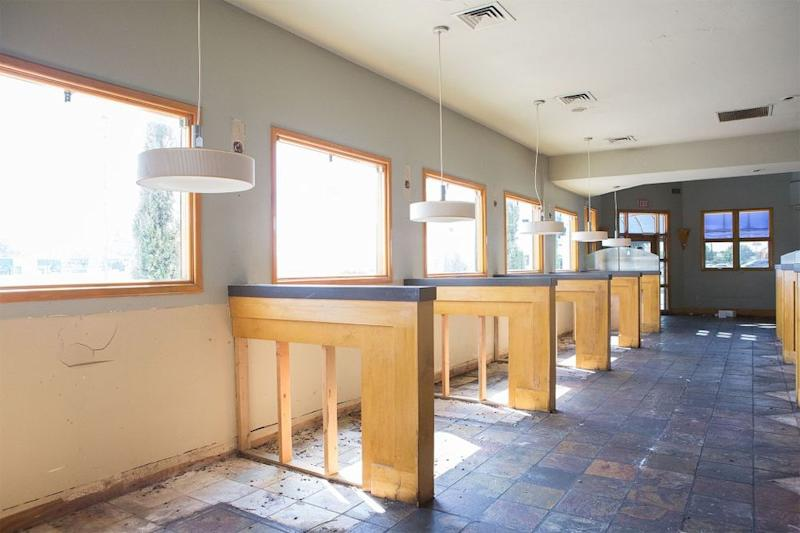 Before: As seen on Fixer Upper, the Elite Cafe had long walkways throughout the restaurant with booth and table seating on each side.